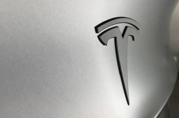 Tesla logo on a silver background