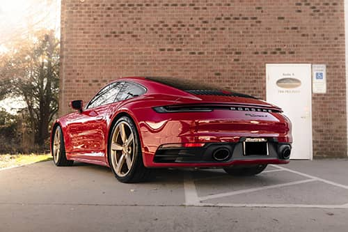 red porsche with dual exhaust